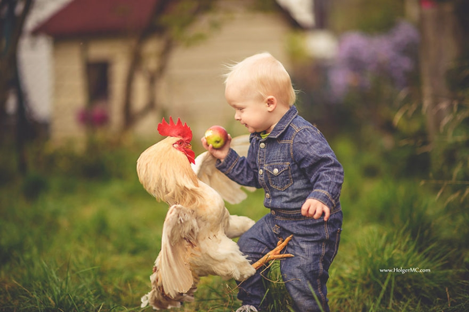 Amazing shots of children and animals from different parts of the world 23