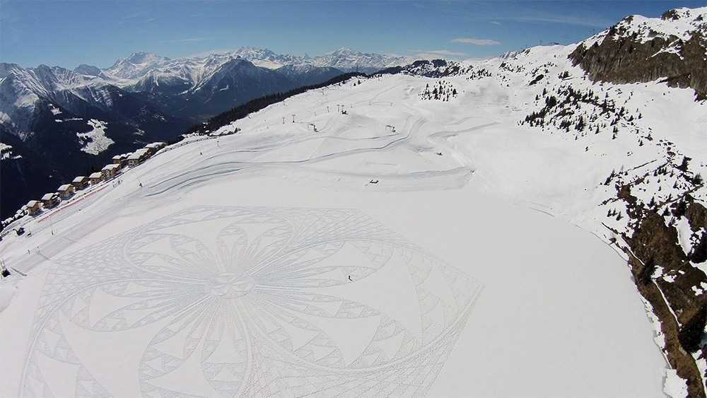 Large-scale geometric patterns, trampled by Simon Beck in the snow and sand 10