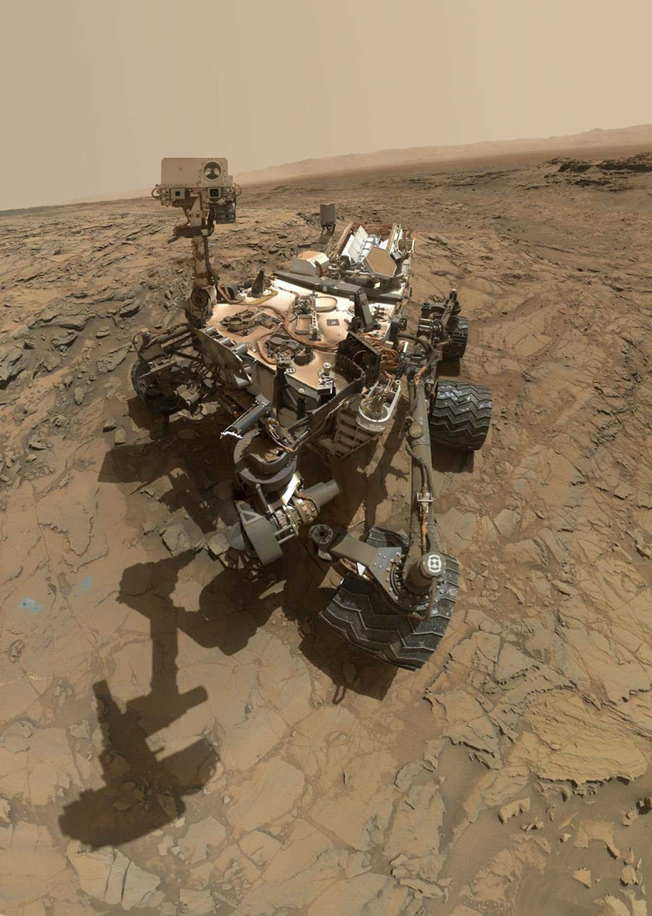 Curiosity makes a selfie among the dunes and digging in the sand 03