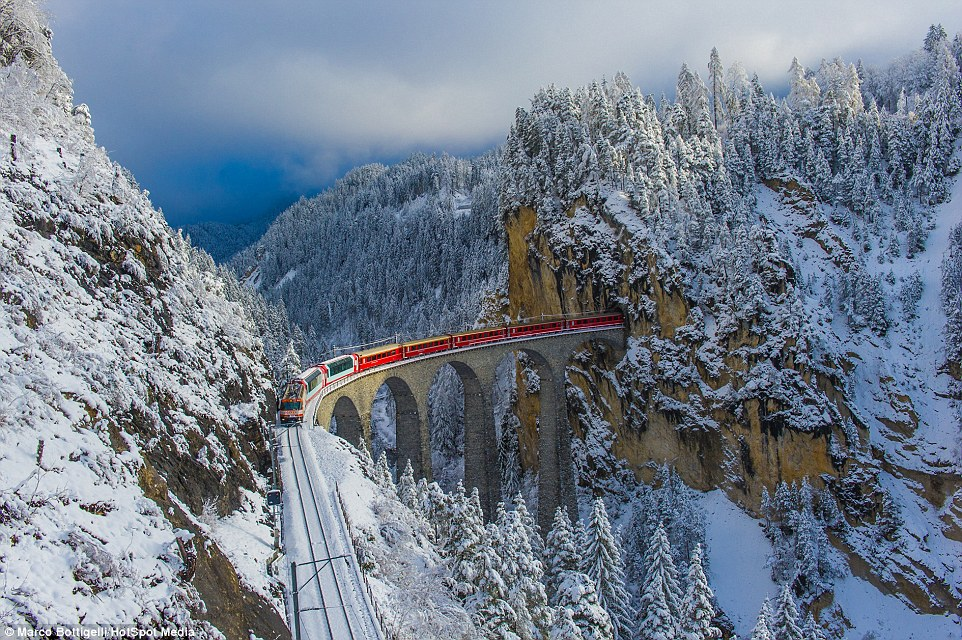 The railway, which passes in the scenic Swiss Alps 02