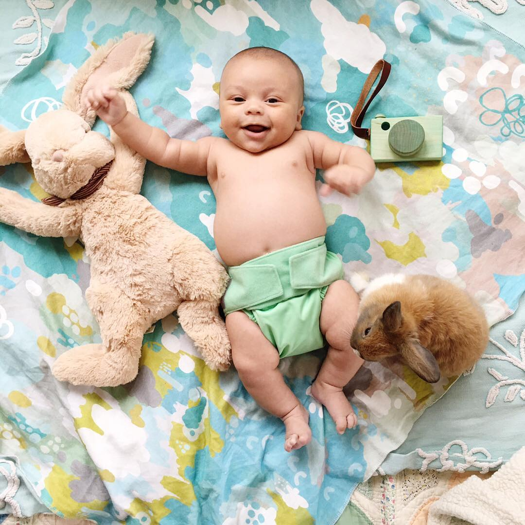Adorable photo shoot of friendship baby with rabbits, created by the mother 03