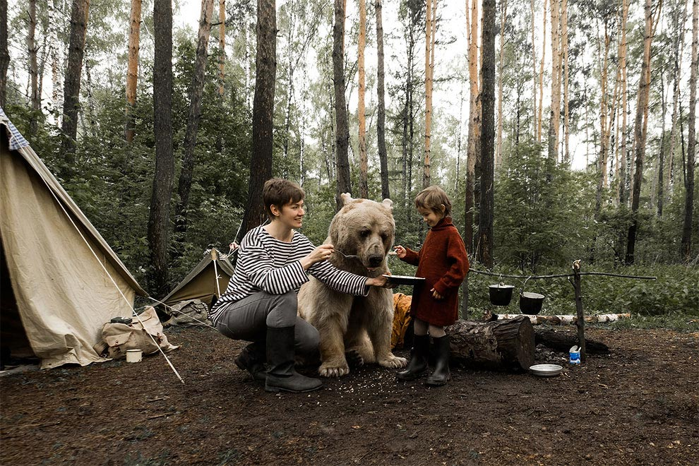 Like in a fairy tale. pictures of Russian family playing with a bear 05