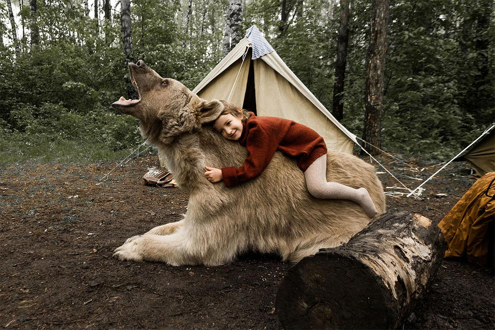 Like in a fairy tale. pictures of Russian family playing with a bear 07