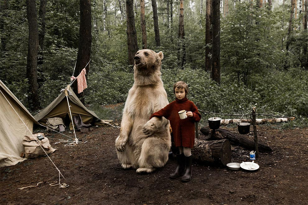 Like in a fairy tale. pictures of Russian family playing with a bear 08