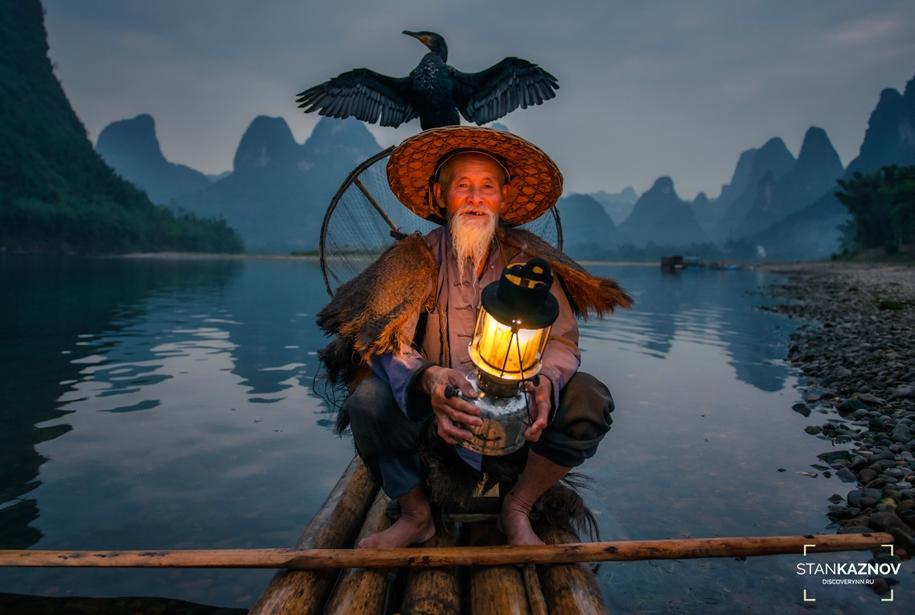 Рыбаки с бакланами на реке Ли